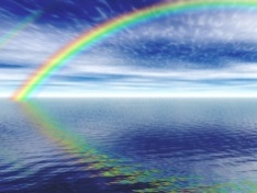 Rainbow reflecting over still water